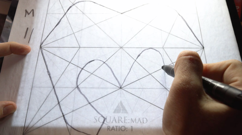 dynamic symmetry-How to design a book cover and abstract letters-drawing-an-abstract-M-on-the-lightpad
